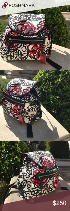 COACH Authentic Daisy Floral Graffiti Backpack Brand new COACH Black patent leather trim, cream/black/red/pink exterior with a beautiful magenta satin fabric interior. Nickel hardware with a magnetic flap closure. Condition: brand new no stains. Perfect condition Coach Bags Backpacks