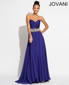 Jovani 88238 Style# : 88238 Available Color(s): Blush, Emerald, Purple, Red Jovani strapless elegant long chiffon gown features a ruched bodice with beaded belt and empire waist