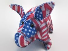The Patriotic Pig, Im proud to make him, and the other Patriotic Critters I have made, too. These are such different times than when I grew up. Anyway...It is 5 from tail to snout, 3 tall, with a wingspan of 5, tip to tip.  Cosmos Critters, if bought for a child are toys to be played with gently. Please know that small beads or buttons are used for the eyes. Please make a note when purchasing if this is to be a childs toy. For adults, they are wonderful Office/ Workspace Critters and are...