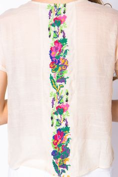 Love embroidered tops.