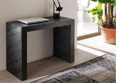Mesa consola transformable en una amplia mesa de comedor.