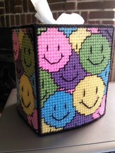Happy Faces tissue box cover. Comes in bright colors: yellow, turquoise, lime green, pink & purple with black trim and accents. Colors somewhat