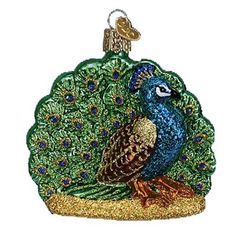 """Proud Peacock Bird Christmas Ornament 16074 Merck Family Old World Christmas **Introduced 2009** Ornament measures approximately 3 1/4"""" Made of mouth blown, hand painted glass"""