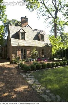 French Country House Exteriors | ... stone edging, front patio of French country style home boxwood hedge