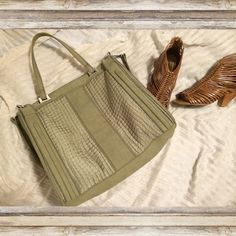 Kelsi Dagger Grand Weekender Grey/Green Tote Industrial style bag by designer Kelsi Dagger. Very eyecatching, not sure I want to part with it! Top center zip closure. Roomy interior with black and white lining. 1 interior zip pocket, 2 interior slip pockets. Detachable crossbody strap. Has some signs of wear that are most viable on the sides (see third photo) but overall great condition. Kelsi Dagger Bags Totes