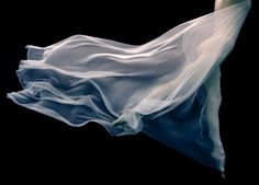 """Howard Schatz """"Underwater"""" Transparency makes her almost religeos icon."""