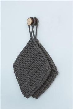 Ferm Living knitted pot holders in charcoal.