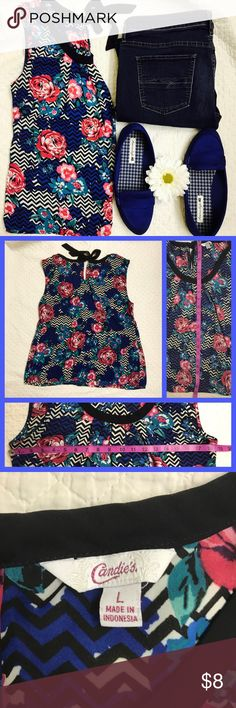 Candie's Sleeveless Tie Back Top Lightweight and great to wear anywhere. No stretch. No flaws. Ties together in the back. Black/white chevron print with blue and pink roses. Colors true to cover pic.  Feel free to ask questions and I'll do my best to answer as quick as I can. 😺 Candie's Tops