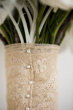 bouquet wrapped with lace. Wish I had thought of this. Would have used some from my mom's dress to tie that in.