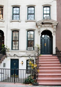 Audrey's Breakfast at Tiffany's' apartment. Black door + pink stoop!