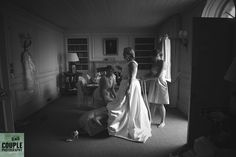 The bride's friends helping her get ready before the ceremony. Weddings at Cliff At Lyons by Couple Photography.