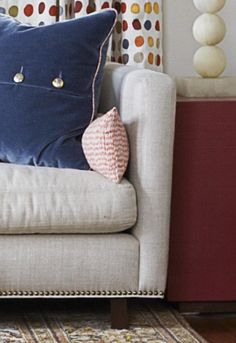 Some great tips here and I love how the rug inspired the color scheme. The navy mohair pillows look perfect with the sofa and the nailheads added bling to the sofa. Big Pillows, Velvet Pillows, Furniture Making, Home Furniture, Teen Lounge, Adams Homes, Sarah Richardson, Living Spaces, Living Rooms