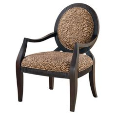 Bring striking safari-inspired style to your decor with this eye-catching arm chair. Showcasing an elegant Louis silhouette and bold leopard-print upholstery...