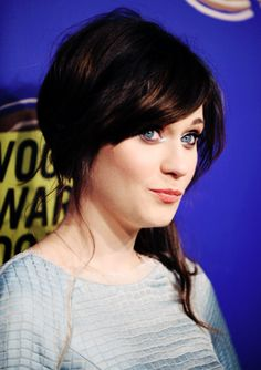 Zooey Deschanel (she looks a lot like Emilie de Ravin in this shot)
