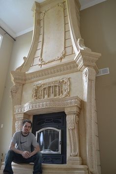 I usually don't like the traditional look but this cast stone fireplace is amazing. All the layers of detail!