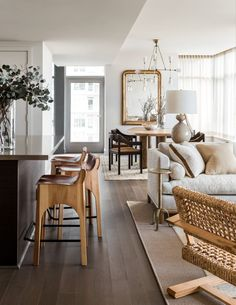 Wood with a pop of gold. Modern living room and kitchen stools.
