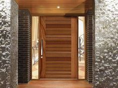 Entrance: Example of Pivot timber Entry Door - Corinthian Pivot Windsor Less expensive option is to paint existing front door same grey as feature wall. House Main Door Design, Wooden Main Door Design, Bedroom Door Design, House Front Door, Front Door Design, Contemporary Front Doors, Modern Front Door, Wooden Front Doors, The Doors
