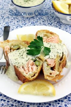 Salmon en Croûte with Lemon Dill Sauce - This is a classic French dish with salmon and asparagus tucked inside puff pastry and baked with a fresh, bright lemon dill sauce for serving. Impressive enough for a special occasion but easy enough for everyday