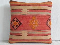 DECOLIC DECORATIVE PILLOW Turkish Kilim Pillow Red Cream Embroidered Pillow 16x16 Handwoven Region Sivas Wool Pillow Ethnic Pillow. $43.00, via Etsy.