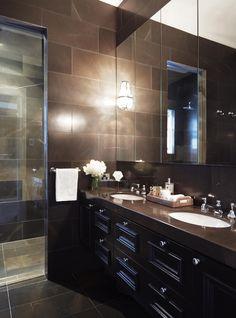 dark classic bathroom by Denai Kulcsar Interiors