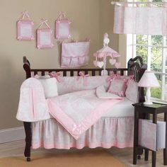 BEDDING This elegant baby girl crib bedding set uses a traditional French toile print with a super soft chenille and coordinating gingham, decorated in satin bows as a special accent. This collection uses the stylish colors of pink and white.