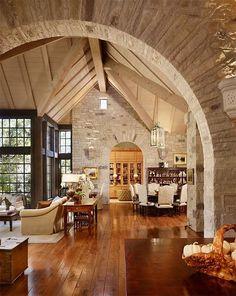 Gorgeous Open Floor Plan  Decor....Beautiful Windows, Stone walls  warm wood flooring...