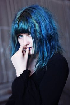 Blue slightly faded #hair #hairstyle #color #blue  www.doctoredlocks.com