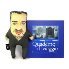 """1 Laroca Doll """"José Luís Peixoto"""" and 1 Book """"Quaderno di viaggio Tempo, vino, taverne in Toscana"""" A gift for lovers. José Luís Peixoto, born in the village of Galveias, Alentejo, is one of the most acclaimed Portuguese writers. Author of several books like Nenhum Olhar, Cal, Galveias. His work has been translated into 20 languages."""
