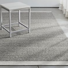 Due to their low pile, flatweave rugs are a must-have item in any home. They're easy to clean, hang on to less dander and allow chairs to slide making them ideal for offices or dining rooms. Handwoven of rayon-nylon yarn for a ribbed effect, our contemporary Desi rug in neutral light grey is framed by tonal bands for a crisp, tailored look.