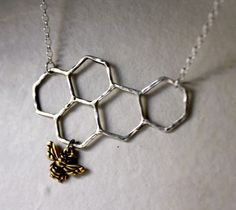 A cute little honeycomb & bee necklace!  http://www.etsy.com/listing/36433809/ready-to-ship-sweets-for-the-sweet