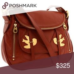 1-Day Sale! Marc by Marc Jacobs Petal to the Metal RARE gorgeous Marc by Marc Jacobs Authentic brown Natasha petal to the metal cross body leather bag. Beautiful flower patterns inside. Some wear to the leather and on birds. Dust bag included. Ready for fall with this vintage-style lamb leather rare designer! Marc by Marc Jacobs Bags Crossbody Bags
