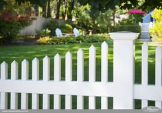 What's the best PVC vinyl fence brand out there? Illusions Vinyl Fence of course. Here's a Classic White PVC vinyl picket fence in a beautiful backyard setting. #illusionsfence #backyardideas #bestfence #whitepicketfence