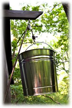 Bucket dumbwaiter going from balcony to patio.  By treehouseaccessories.com