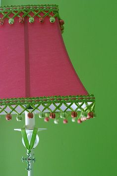 Pink lampshade and green painted walls -- interesting, bright color scheme.