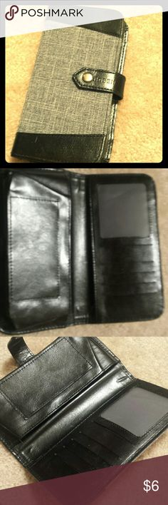 Cell case/Wallet Can be a cell case/carrier and/or wallet. Has 4 card slits with an extra see-through slit that is perfect for a license/ID. Has a large pouch to carry phone or small accessories and a tiny pocket also great for small accessories like lip gloss/stick/chapstick. Never used, no original tags. Has a button buckle clasp to keep items safe inside, Jean and suede - like material Orben Accessories Phone Cases