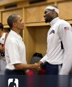 President Barack Obama talks with LeBron James as First Lady Michelle Obama hugs Deron Williams during their greet with members of the U.