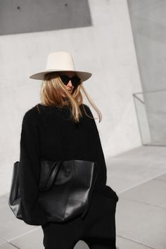 Janessa Leone hat, Céline bag & sunglasses, Acne Studios knit jumper. Via Mija