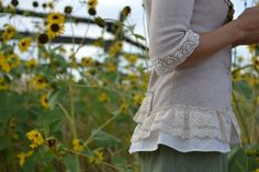 We saw these at a craft show.. so adorable- thrift store sweater recycled with lace and ribbons- sweater refashion