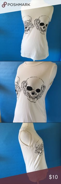 "Skull graphic muscle tank - m Nwot. Never worn. Purchased a large, fits more like a medium. No tags anywhere in the top. I'd say cotton, size medium. The material is really nice quality very thick. Fun skulls making up ""hear no evil, see no evil, speak no evil"" Tops Muscle Tees"