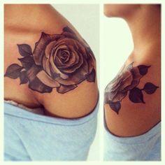Cool rose tattoo on shoulder.