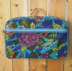 1970s Blue Floral Suitcase This is so unreal. I seriously had one EXACTLY like this. It's like looking at a picture of my own bag.
