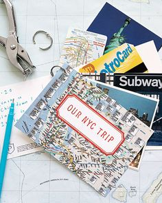 Doing this! Martha Stewart Living, June 2008    If you hate the idea of grappling with vacation memorabilia after a trip, create a keepsake as you go. Pack a hole punch and a loose-leaf ring to string together maps, postcards, and other souvenirs you collect on the road. When you get home, make a cover by affixing a sticker to the front and rubber-stamping a title on top.