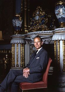 The Duke of Edinburgh photographed beside one of the many ornate chinoiserie fireplaces, Buckingham Palace, brought from the Brighton Pavilion.