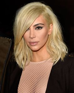 Kim Kardashian continued to flaunt her new blonde locks in Paris [Getty]