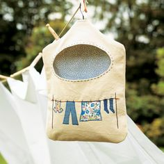 Learn to make this cheerful embroidered peg bag - the perfect handmade gift for mum, or yourself! So quick & easy to sew.