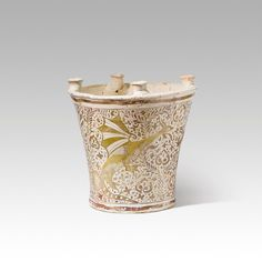 Alfabreguer. Primera meitat del segle XV. Paterna o Manises. Sèrie del reflex daurat