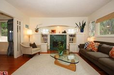 Unusual cozy Craftsman fireplace, with built-in benches and recessed arched alcove (?). SoCal.
