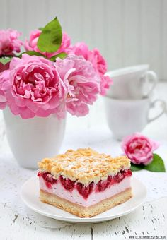 Foam Cake with pudding and raspberries