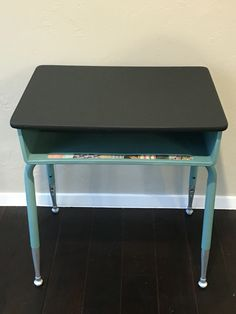 Old school desk refinished into side table with storage for nursery.
