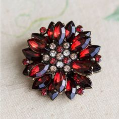 Anusha Dena Burgundy Crystal Brooch ($26) ❤ liked on Polyvore featuring jewelry, brooches, crystal jewelry, crystal jewellery, crystal stone jewelry and crystal brooch